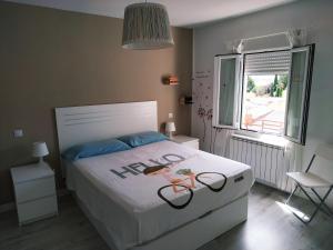 Una habitación en Loló Vivienda de uso Turístico 09-27