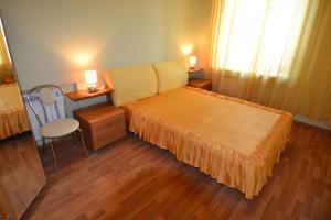 Кровать или кровати в номере Сити Инн Апартаменты Савеловская