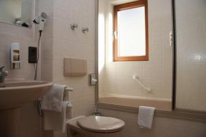 Ein Badezimmer in der Unterkunft City Hotel Sindelfingen