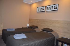 Кровать или кровати в номере Отель Аура