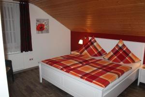 Ein Bett oder Betten in einem Zimmer der Unterkunft Ferienwohnung Haus Friederike ab 6 Übernachtungen, inclusive Meine Card Plus