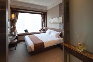 Cama o camas de una habitación en Rosedale Hotel Kowloon