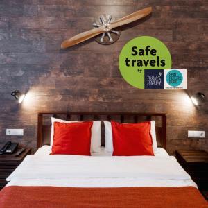 Кровать или кровати в номере Liki Loft Hotel