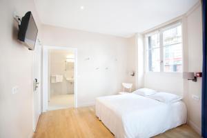 Cama ou camas em um quarto em Nadaud Hotel