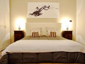 A bed or beds in a room at L'Una di Notte