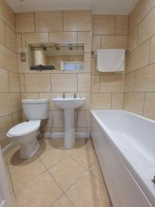 A bathroom at Charnwood Regency Guest House