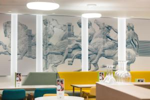 A restaurant or other place to eat at ibis Styles Athens Routes
