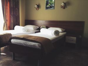 Кровать или кровати в номере Южанка