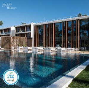 The swimming pool at or near Aroeira Lisbon Hotel - Sea & Golf