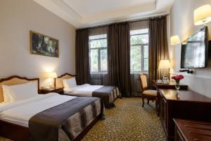 Кровать или кровати в номере Отель Новомосковская