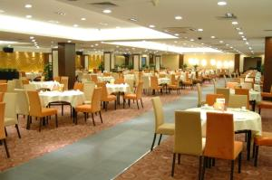 A restaurant or other place to eat at Star Hotel