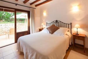 Een bed of bedden in een kamer bij Agroturisme Can Planells