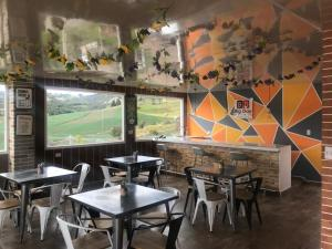A restaurant or other place to eat at Big Day Hotels-Lago de Tota