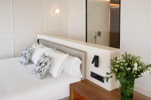 Un ou plusieurs lits dans un hébergement de l'établissement Arrecife Gran Hotel & Spa