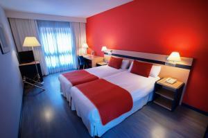 Cama o camas de una habitación en Ibis Styles Zaragoza Ramiro I