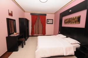 Cama ou camas em um quarto em Najmat Manami Azizyya