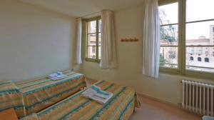 Cama o camas de una habitación en Apartamentos Montserrat Abat Marcet
