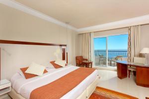 Een bed of bedden in een kamer bij Iberostar Selection Royal El Mansour