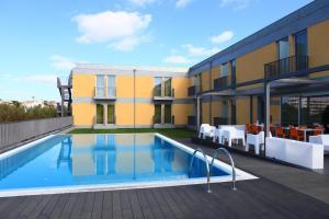 A piscina em ou perto de Hotel 3K Faro Aeroporto