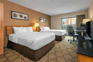 A bed or beds in a room at Comfort Inn Kenora