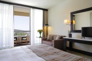 Krevet ili kreveti u jedinici u okviru objekta Porto Carras Sithonia
