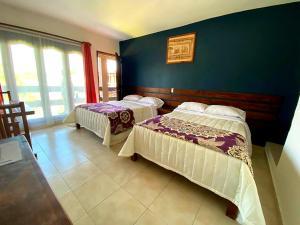 Cama o camas de una habitación en La Finca del Abuelo Teotihuacan