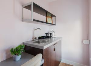 A kitchen or kitchenette at Lightotel Veldhoven Airport