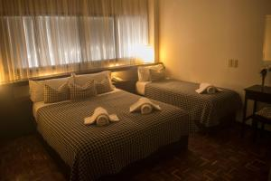 A bed or beds in a room at Hotel Gran Vendimia by Bouquet
