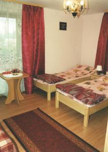 A bed or beds in a room at Pokoje Gościnne Łukaszczyk