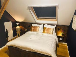 Een bed of bedden in een kamer bij Residence 1898
