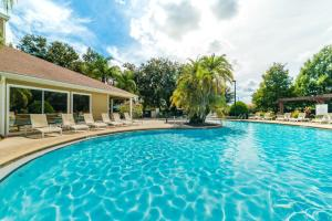 The swimming pool at or close to Lucaya Village Resort 4 Bedroom Vacation Townhome 1715