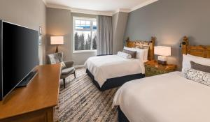 A bed or beds in a room at JW Marriott The Rosseau Muskoka Resort & Spa