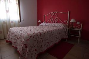 A bed or beds in a room at Apartamentos Barrena