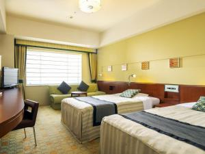 A bed or beds in a room at Tokyo Bay Maihama Hotel First Resort