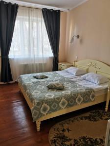 Кровать или кровати в номере Прованс отель 4 Сезона