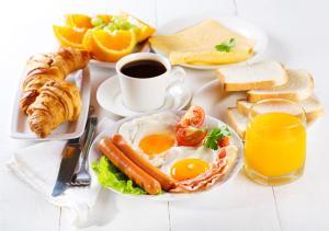 Завтрак для гостей Residentsiya Hotel