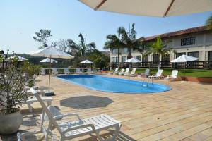 The swimming pool at or close to Morro do Sol Hotel & Eventos