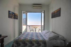 Letto o letti in una camera di Villa Casola B&B