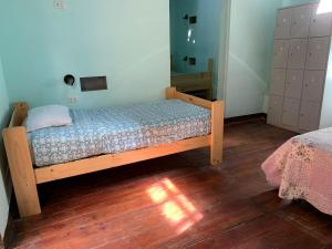 A bed or beds in a room at Wild Olive Guest House