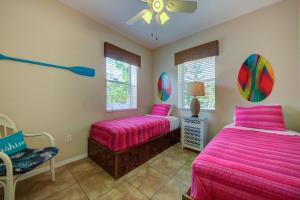 A bed or beds in a room at The Ringling Beach House