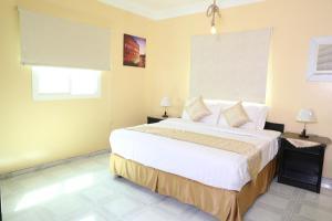Cama ou camas em um quarto em Elite Suites Residential Unites-الصفوة المميزة للوحدات السكنية