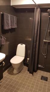 Ett badrum på Apartments Uppsala - Portalgatan