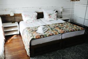 Кровать или кровати в номере Бутик Отель Маруся