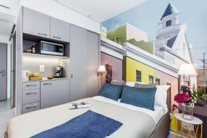 A bed or beds in a room at VISIONAPARTMENTS Rue des Communaux - contactless check-in