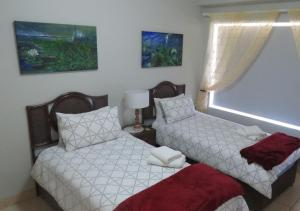A bed or beds in a room at Adagio Luxury Self Catering