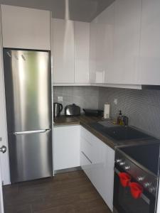 A kitchen or kitchenette at CasaDiNova2