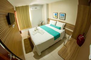 A bed or beds in a room at Pousada Capital das Águas