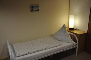 A bed or beds in a room at Landhaus Ayurvedicus