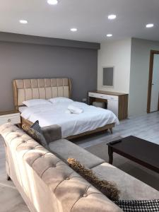 A bed or beds in a room at Best Hotel Pendik