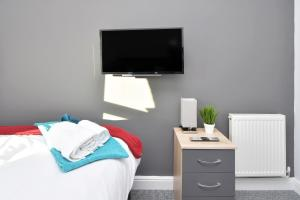A television and/or entertainment center at Townhouse @ Brunswick Place Stoke